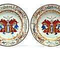 A pair of Dutch market <b>armorial</b> <b>plates</b>, circa 1740