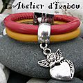 <b>Bracelet</b> destiné aux filles en cuir <b>double</b> <b>rang</b> rose et jaune et agrémenté d'une breloque d'un ange accoudé sur un coeur !