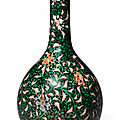 A <b>black</b>-<b>ground</b> famille verte 'floral' bottle vase, Qing dynasty, Yongzheng period (1723-1735)