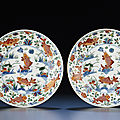 A rare pair of finely painted wucai 'fish' <b>dishes</b>, Kangxi period (1662-1722)