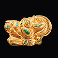 A Sarmatian gold and turquoise lion-griffin head appliqué, circa <b>3rd</b>-<b>1st</b> <b>century</b> <b>B</b>.<b>C</b>.