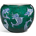 A blue and white and later green enamelled fish jar, Qing dynasty, <b>Kangxi</b> <b>period</b> (<b>1622</b>-<b>1722</b>)