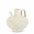 A rare Cizhou 'peony-scroll' carved ewer, Northern Song-Jin Dynasty (960-1134)