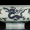 A fine and rare doucai <b>dragon</b> bowl, Kangxi six-character mark and of the period (1662-1722)