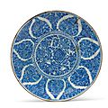 A large safavid blue and white pottery dish, iran, late 17th or early 18th century