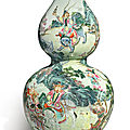 A rare famille-rose '<b>Tribute</b> <b>bearers</b>' double gourd vase, Qianlong seal mark and period (1736-1795)
