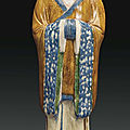 A large <b>blue</b> <b>and</b> <b>sancai</b>-<b>glazed</b> <b>pottery</b> figure of a court official, China, Tang dynasty (AD 618-907)