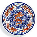 A magnificent and rare underglaze-blue and iron-red decorated 'Nine <b>Dragon</b>' <b>charger</b>, Seal mark and period of Qianlong