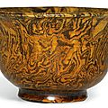 An amber-glazed marbled <b>pottery</b> cup, Tang dynasty (618-907)