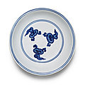 A blue and white 'dragon and <b>lingzhi</b>' <b>dish</b>, Wanli six-character mark and of the period (1573-1620)