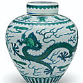 A green-enameled and underglaze blue 'dragon' jar and <b>cover</b>, Qianlong six-character seal mark and of the period (1736-1795)