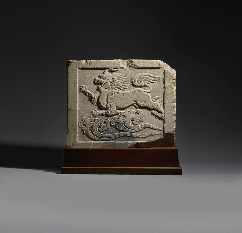 A very rare white marble 'Mythical beast' stone panel, early Tang dynasty (618-907)