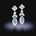 An important pair of fancy <b>colored</b> diamond and diamond earrings