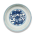 A blue and white '<b>Buddhist</b> <b>lions</b>' saucer-dish, Xuande six-character mark and of the period (1426-1435)