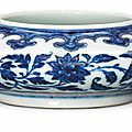 A fine <b>Ming</b>-<b>style</b> <b>blue</b> <b>and</b> <b>white</b> 'floral scroll' water pot, Yongzheng six-character mark <b>and</b> of the period (1723-1735)