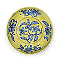 Lot 37. Property from the Cunliffe Collection. A rare underglaze-blue yellow-ground 'gardenia' saucer dish, Zhengde six-character mark and of the period (1506-1521); 19.8cm (7 7/8in) diam. Sold for £230,500 (€292,668). Photo: Bonhams.