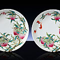 A superb rare pair of famille rose '<b>peach</b>' <b>dishes</b>, Yongzheng six-character marks within double-squares and of the period