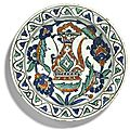 An iznik polychrome pottery dish with ewer, turkey, early 17th century