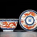An iron-red and underglaze <b>blue</b> <b>dragon</b> and phoenix teabowl and cover, seal marks and period of Jiaqing (1796-1820)