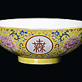 A porcelain bowl with <b>Famille</b> <b>Rose</b> yellow background, China, Qing Dynasty, Jiaqing Mark and Period (1796-1820)