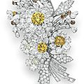 A <b>colored</b> diamond and diamond flower brooch, by Bvlgari