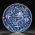 A <b>blue</b> <b>and</b> <b>white</b> <b>reverse</b>-<b>decorated</b> 'dragon' dish, Daoguang seal mark in underglaze <b>blue</b> <b>and</b> of the period (1821-1850)