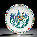 A rare and finely enamelled doucai 'mythical horse' dish, yongzheng six-character mark within double circles and of the period