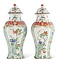 A pair of <b>famille</b> <b>verte</b> octagonal vases and covers, Kangxi period (1662-1722)