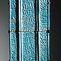 Two monumental turquoise-glazed calligraphic tiles, signed by Yusuf Ibn 'Ali [Ibn] <b>Muhammad</b> Ibn Abi [Tahir], probably Kashan