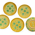A rare set <b>of</b> five yellow-ground green-enamelled 'lotus' saucer dishes, <b>Jiajing</b> <b>six</b>-<b>character</b> incised <b>marks</b> <b>and</b> <b>of</b> <b>the</b> <b>period</b>