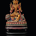 A gilt-lacquered and painted bronze figure of manjushri, ming dynasty,circa16th century