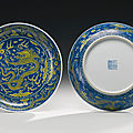 A pair of underglaze blue <b>and</b> yellow-enameled 'dragon' dishes, <b>Qianlong</b> <b>seal</b> <b>marks</b> <b>and</b> <b>period</b> (1736-1795)