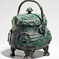 A very rare and exceptional bronze ritual <b>owl</b>-form wine vessel, xiao you, late Shang dynasty, 12th-11th century BC
