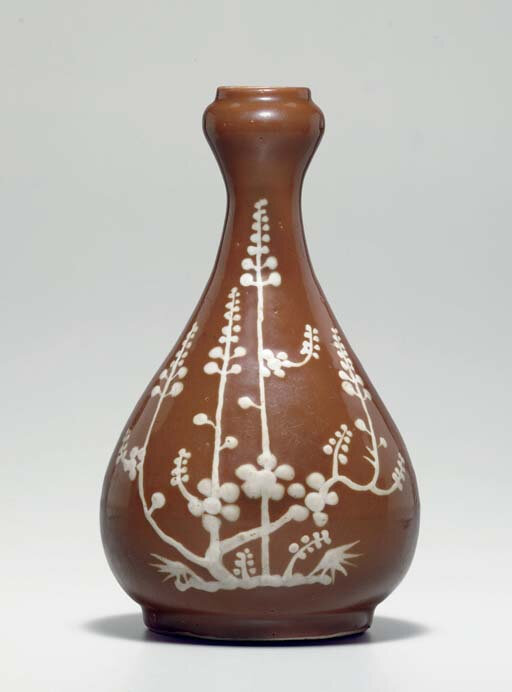 A rare slip-decorated brown-glazed pear-shaped vase, Wanli period (1573-1619)