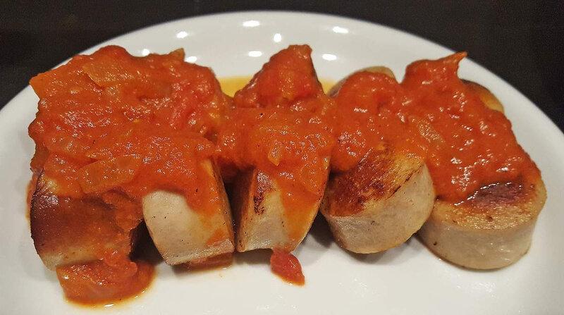 Saucisse à la tomate & au curry
