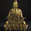 A rare gilt-bronze seated figure of a <b>Daoist</b> deity, Qing dynasty, 18th century