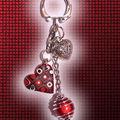 Bijou de sac coeur multi rouge et miracle rouge dans spirale (N)