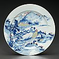 An underglaze-blue and copper-red decorated celadon-glazed dish, Kangxi period, circa 1700