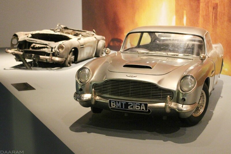 Two scale models (destroyed or not) of the famous Aston Martin DB5. «Skyfall» 2012. Photo: Olivier Daaram Jollant © 2016