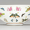 A famille rose '<b>butterfly</b>' bowl, Guangxu six-character mark in iron red and of the period (1875-1908)