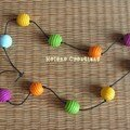 Collier Boules miel multicolore - 15€