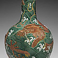 A large <b>iron</b>-<b>red</b>-decorated green and white-enameled carved vase,tianqiuping, 18th-19th century