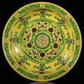 An extremely rare fine green and aubergine-glazed yellow-ground imperial <b>dish</b>. China, seal mark and period of Qianlong