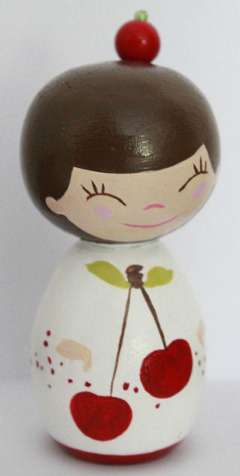 poupée blanche cerise