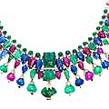 A multi gem-set necklace and earclip suite, circa 1950