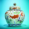 A highly important and extremely rare Wucai 'fish' jar and cover