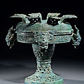 A large archaic bronze ritual vessel and cover, pu, <b>Eastern</b> <b>Zhou</b> <b>dynasty</b>