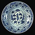Plate with grape design. porcelain with underglaze cobalt decoration. ming dynasty. reign of the xuande emperor