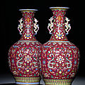 An exceptionally fine <b>and</b> rare pair <b>of</b> ruby-red ground famille rose vases, <b>Qianlong</b> <b>six</b>-<b>character</b> <b>seal</b> <b>marks</b> <b>and</b> <b>of</b> <b>the</b> <b>period</b>