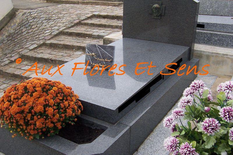 Tombe avec chrysanthème dans jardinière